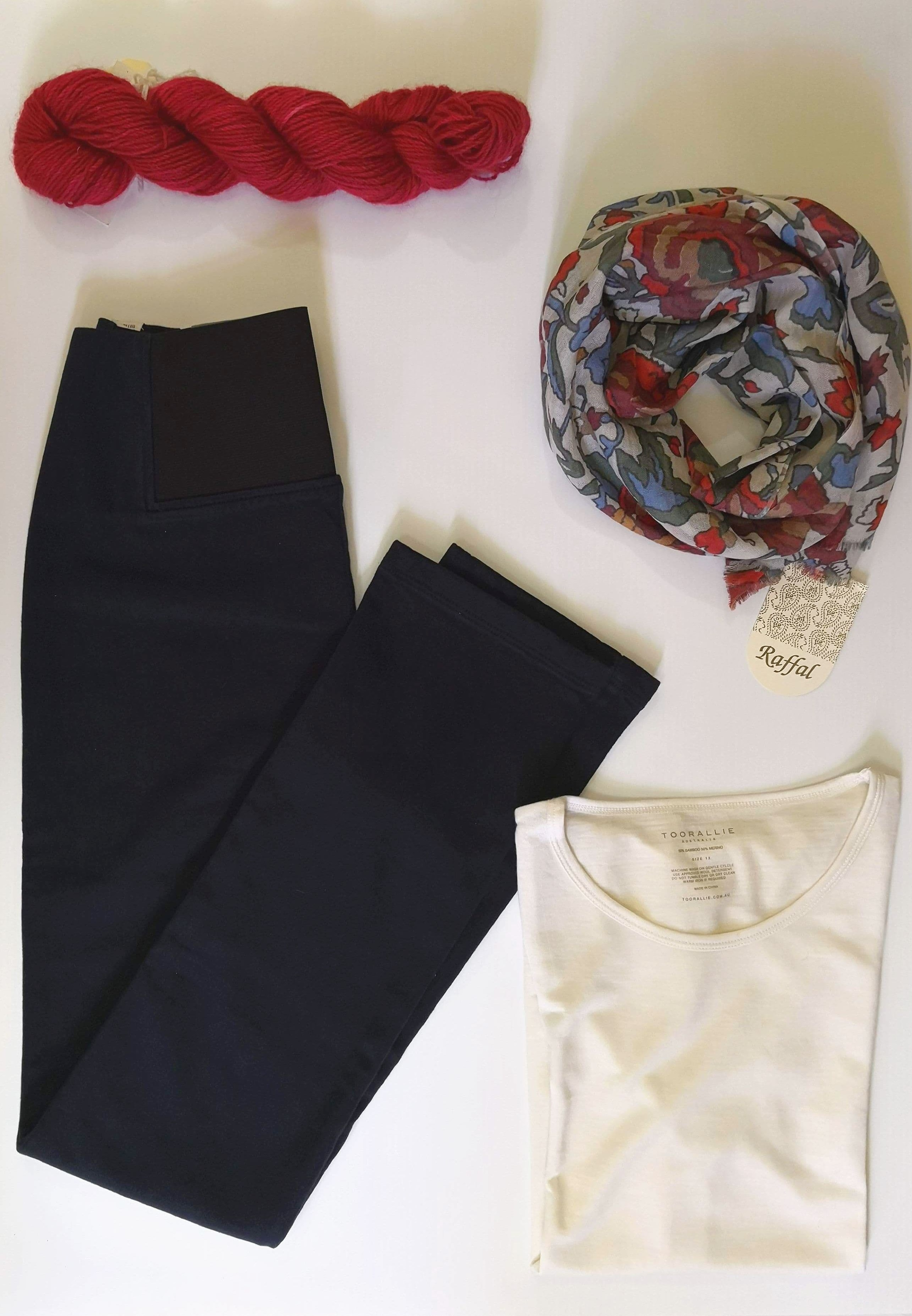 Ladies wear: jeans, t-shirt, scarf, woollen garments
