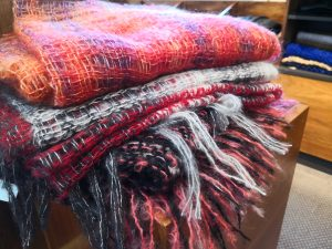 Colourful wraps and throws on display
