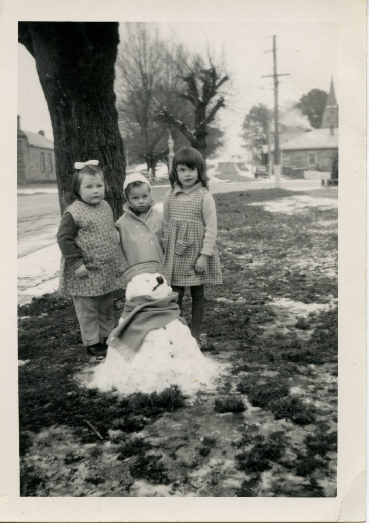 Children with a snowman at Ross, 1960s